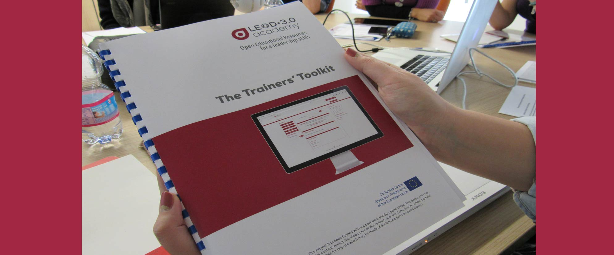 Hands holding The Trainers' Toolkit